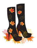 Autumn boots with leaves. Vector illustration. Stock Image