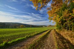 Autumn in the border area. Autumn scene with a path to the Bavarian countryside Royalty Free Stock Image