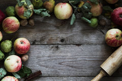Autumn border from fruits on wooden table Royalty Free Stock Image