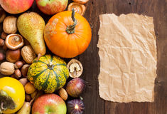 Autumn border and paper on a wooden table Stock Photography