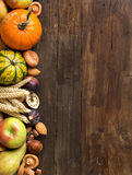 Autumn border on a wooden table Stock Images