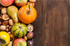 Autumn border on a wooden table Royalty Free Stock Photography
