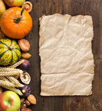 Autumn border on a wooden table Royalty Free Stock Image