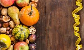 Autumn border on a wooden table Stock Photos