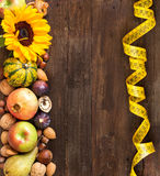Autumn border on a wooden table Stock Image