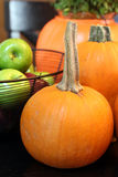 Small Pumpkin Still Life with Apples in Basket Royalty Free Stock Photos