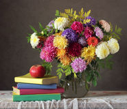 Autumn bouquet, Apple and books. Stock Photo