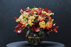 Autumn bouquet. Beautiful autumn bouquet in a glass vase Royalty Free Stock Photos