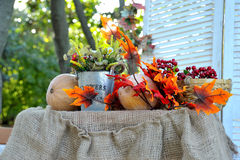 Autumn Bouquet, colorful autumn decoration. Sunflower and berries Stock Photography