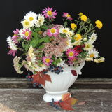 Autumn bouquet of flowers in a white vase Royalty Free Stock Photo