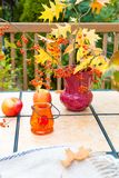 Autumn bouquet on outdoor table. Fall season on family home pati Stock Photo