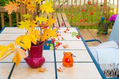 Autumn bouquet on outdoor table. Fall season on family home pati Royalty Free Stock Photo