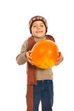 Autumn boy carrying an pumpkin Royalty Free Stock Photos