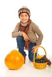 Autumn boy with pumpkin and grapes. Autumn boy with pumpkin and basket with grapes isolated on white background Stock Image