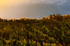 Autumn in Brasov in Romania. An autumn landscape from Brasov in Romania with Carpathian mountains on the background stock images