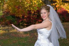 Autumn Bride. Smiling after looking at her rings royalty free stock photography