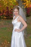 Autumn Bride. Posing in the park royalty free stock photo