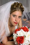 Autumn Bride. With bouquet and leafs laying on her bed stock images