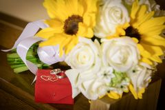 Autumn bride bouquet with sunflowers and white roses royalty free stock photo