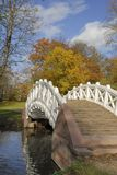 Autumn Bridge. A bridge with a white railing on an unusually mild mid-November day in a park in southern Germany Royalty Free Stock Photo