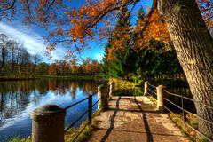 Autumn bridge. With nobody. Sunny autumn day Royalty Free Stock Images