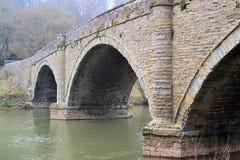 Autumn bridge over a river. Autumn stone bridge over a river Royalty Free Stock Photo