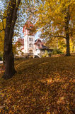 Autumn and bright colors. small white castle. Autumn fairytale forest tree Stock Photo