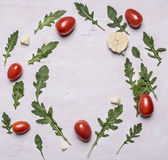 Autumn brown garlic tomato arugula lined circle frame  on wooden rustic background top view space for text Stock Photos