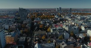 Riga city Autumn buildings living houses Drone flight sunny day. Autumn buildings in the Town Drone flight houses blocks of flats, sunshine flight stock video