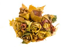 Autumn bunch. Of flowers made of fallen leaves Stock Image