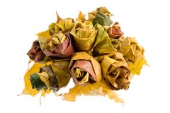 Autumn bunch. Of flowers made of fallen leaves Stock Photo
