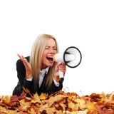 Autumn businesswoman with megaphone Royalty Free Stock Photo