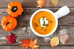 Autumn butternut squash soup on rustic wood background Stock Photo