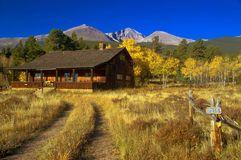Autumn At the Cabin. A country cabin in Colorado shows Longs Peak in Autumn Royalty Free Stock Image