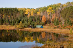 Autumn Cabin on a Northwoods Lake Stock Photos