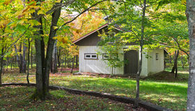 Autumn cabin in the wood Stock Photos