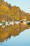 Autumn on Caledonian Canal. At Dochgarroch showing boats and yachts at their moorings Stock Photography