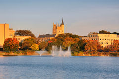 Autumn Campus Scene. Autumn Morning Landscape with Lake Fountain, Trees and Buildings in Evanston, Illinois Stock Photos
