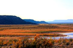 Autumn on the Canadian River. The Canadian River flows across the high plains of New Mexico, USA on a vibrant autumn day; The Canadian is the longest tributary Stock Photo