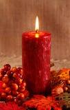 Autumn candle Stock Photos