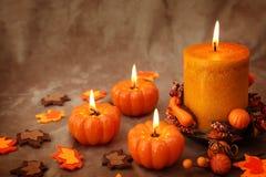 Autumn candles Stock Photos