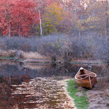 Autumn Canoe. An autumn shot of a woodstrip canoe by the water Stock Photography