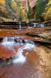 Autumn Canyon. Autumn foliage banks a series of cascaded waterfalls Royalty Free Stock Image