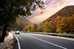 Autumn car trip editorial. VELINGRAD, SEPTEMBER 10: Volkswagen VW Golf 4 car on autumn road, car is blurred from the speed on September 10, 2015 at Velingrad Stock Photography