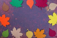 Autumn card with space for text. Tissue leaves on a dark background. Waiting for autumn stock photos