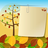 Autumn card and tree leaves. Card pinned to autumn background with trees and colorful foliage Stock Photos