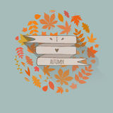 Autumn card. Vintage card with autumn leaves and ribbon Royalty Free Stock Photography