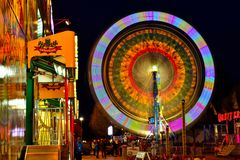 Autumn Carnival. A travelling carnival provides entertainment and an array of color to the evening landscape Royalty Free Stock Images