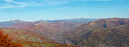 Autumn Carpathian mountain, Rakhiv, Ukraine. Autumn Carpathian Mountains high-resolution panorama landscape with multicolored trees on slopes, Rakhiv town Royalty Free Stock Photography
