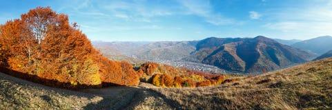 Autumn Carpathian mountain, Rakhiv, Ukraine. Autumn Carpathian Mountains landscape with multicolored yellow-orange-red-brown trees on slope and  Rakhiv town and Royalty Free Stock Photos